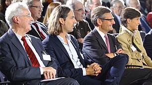 (v. l.) Karl Homann und Christoph David Precht im Publikum